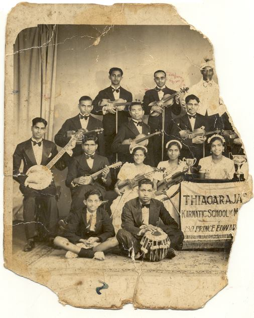 The Thiagaraja Carnatic school of music with Arumugam Govindsamy seated with the tabla